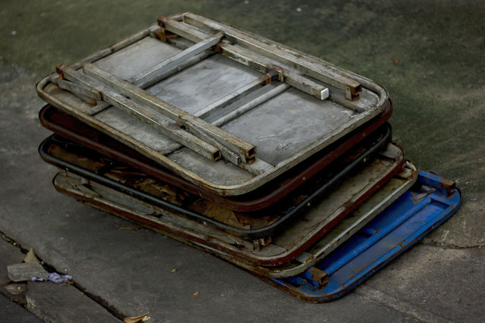 Folding table laid on the floor. Abandoned Car Close-up Day Focus On Foreground Folding Table Folding Tables High Angle View Luggage Metal Mode Of Transportation No People Old Open Outdoors Rusty Stack Street Suitcase Transportation Travel