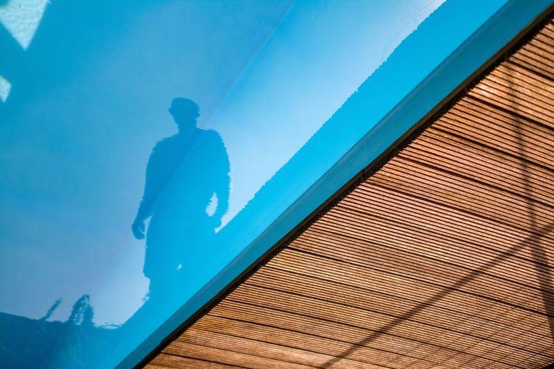 Man reflecting in swimming pool