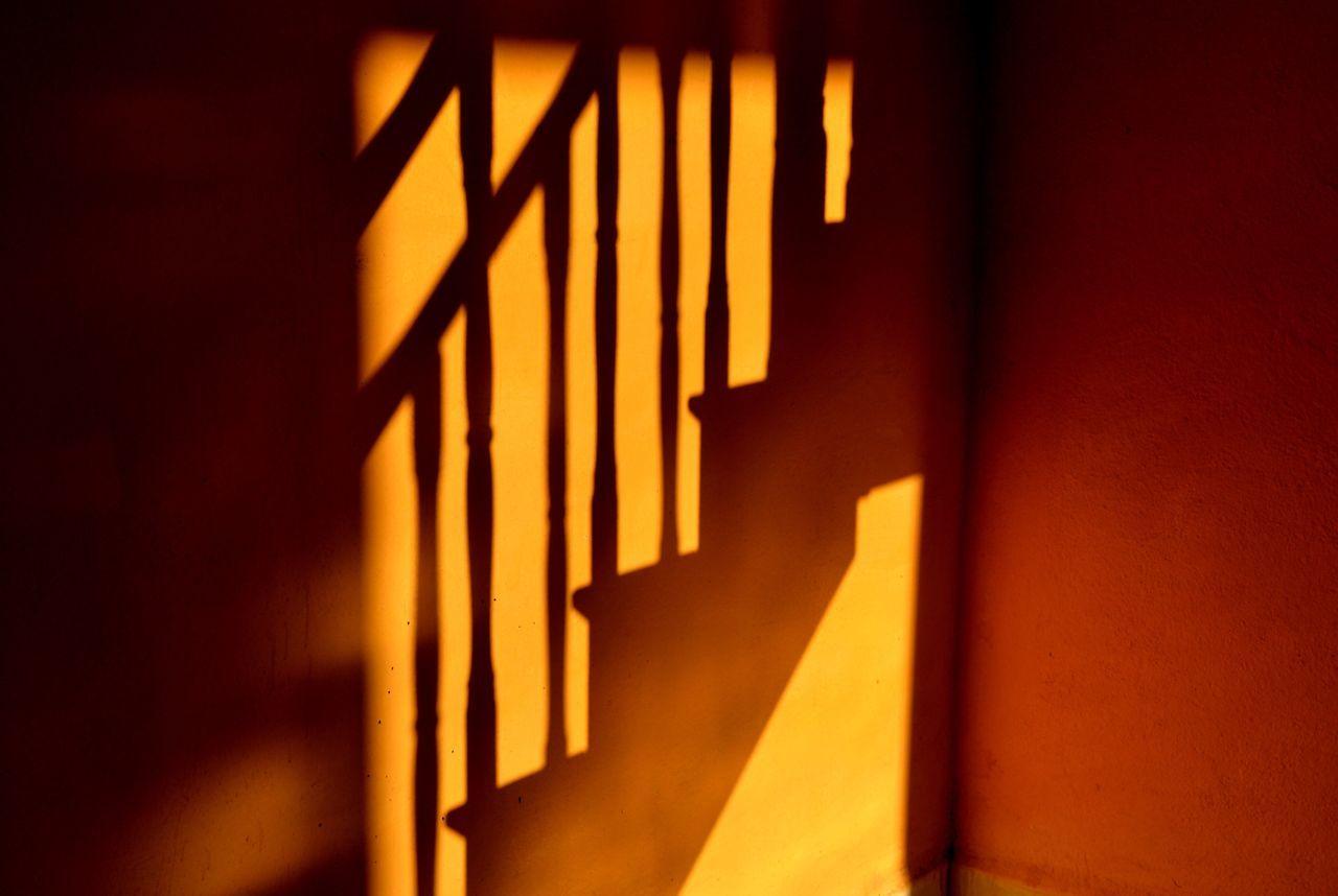 LOW ANGLE VIEW OF ILLUMINATED WINDOW