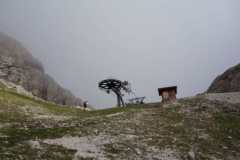 Man Machine Mountain Real People Mode Of Transport Rear View Low Angle View Outdoors Nature Day Mountain Landscape One Person Misty Hiker Rocks Chairlift No Snow