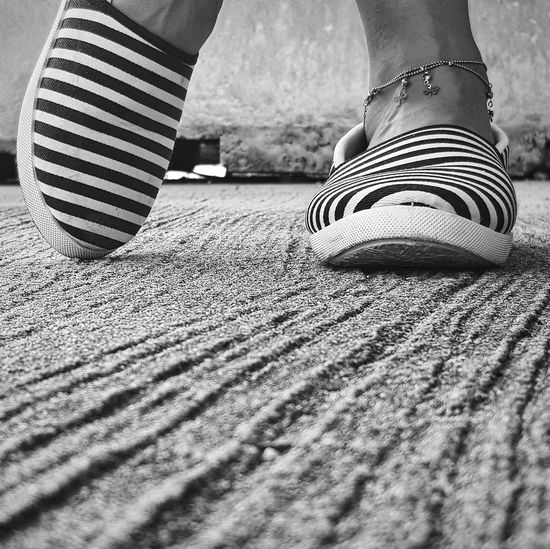 Making a statement. Sand Sandandshoe Traveller Storytelling Perspective Beach Statement Low Section Human Leg Shoe Sock Standing Human Foot Limb Close-up Footwear Canvas Shoe Foot Pair Things That Go Together Flat Shoe