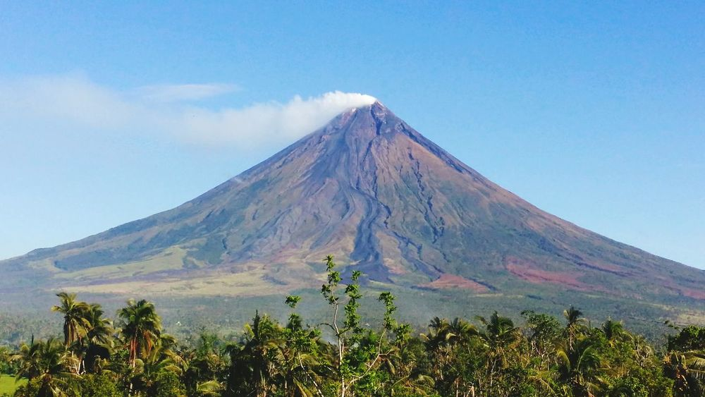 The once perfectly coned shaped volcano. Still a thing to behold. Mayon Volcano Philippines