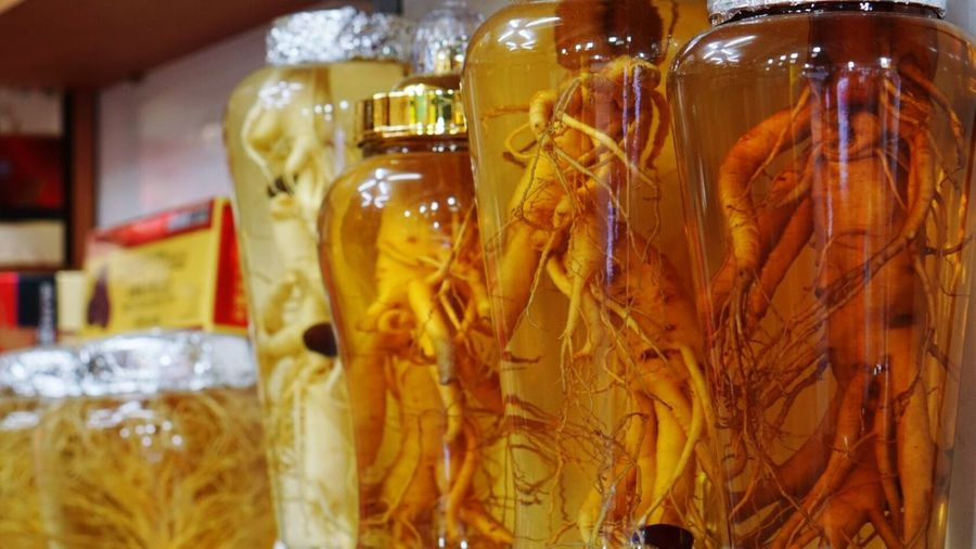 Close-up of ginseng in glass jars