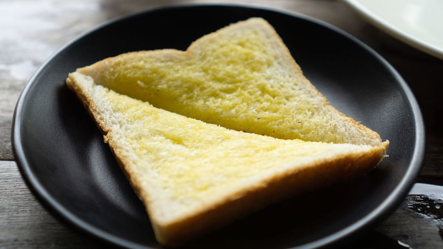 Bread Breakfast Close-up Focus On Foreground Food Food And Drink Freshness Healthy Eating High Angle View Household Equipment Indoors  Indulgence Kitchen Utensil Meal Melting No People Ready-to-eat Snack Studio Shot Toasted Bread Wellbeing