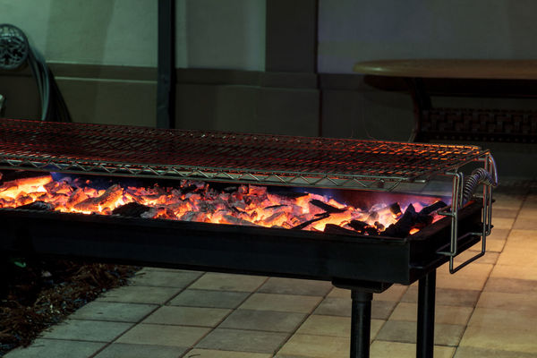 Fire hot coals on a grill ready to cook barbecue outside in the summer BBQ Cooking Flame Flame Broiled Grilling Barbecue Braai Grill Hot Coals Hot Coals Vacation Living With Nature Hot Grill Outdoor Cooking Outdoors Outside Sizzle Summer