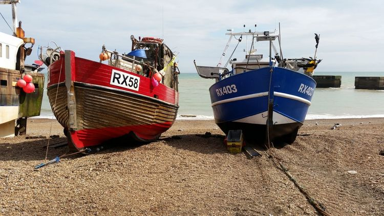 The Stade, a shingle beach in Hastings, East Sussex, is home to Europe's largest fleet of beach-launched fishing boats. Beach Boat Coastline Fishing Fishing Boat Horizon Over Water Nautical Vessel No People Outdoors Sand Sea Shingle Shore Sky Water