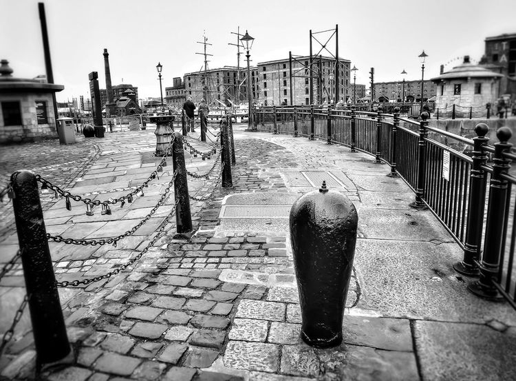 Liverpool's Albert Dock Outdoors Architecture Bnw Photography Bnw_captures EyeEm Masterclass Portrait Photography The World Through My Eyes Creative Light And Shadow Malephotographerofthemonth Fujifilm Liverpool, England History Architecture Architectural Detail Low Angle View Travel Destinations Albert Docks Monochrome Photography Bollards