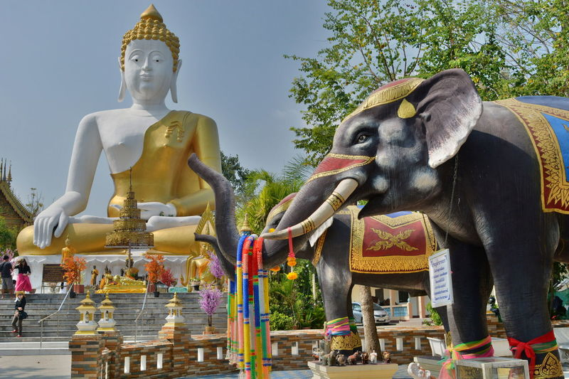 Wat Phra That Doi Kham. Chiang Mai province. Thailand Architecture Buddhism Buddhist Temple Chiang Mai Chiang Mai | Thailand Cultures Elephant Mountain Temple Outdoors Place Of Worship Religion Sculpture Sitting Buddha Spirituality Statue Temple Thai Thailand Wat Phra That Doi Kham