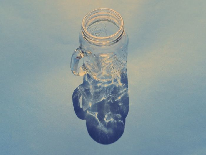 Close-up of ice cubes in glass jar on table