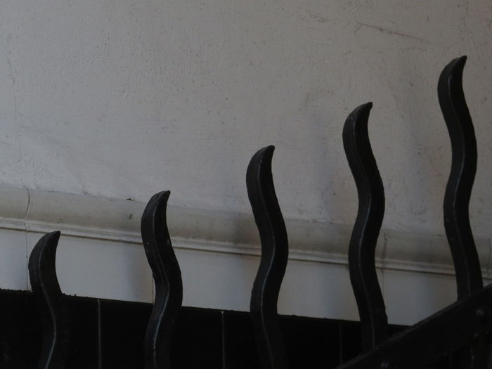 Close-up of chairs against wall
