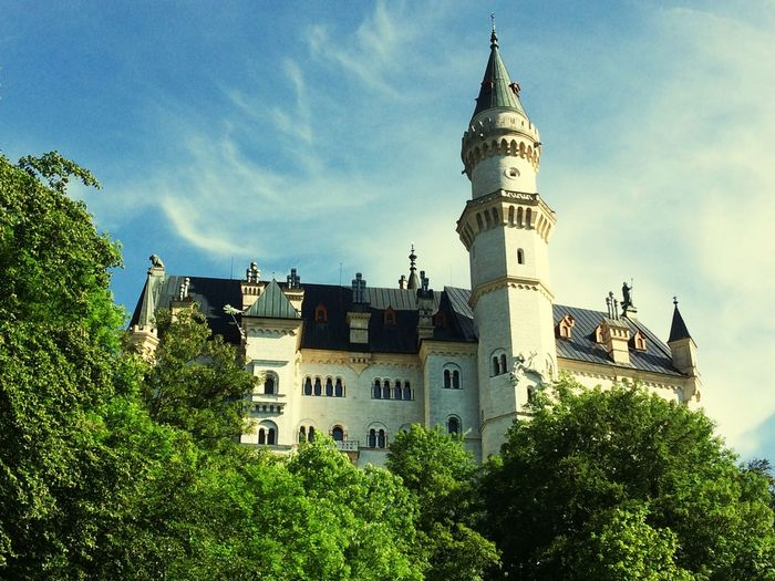 Low angle view of neuschwanstein castle against sky