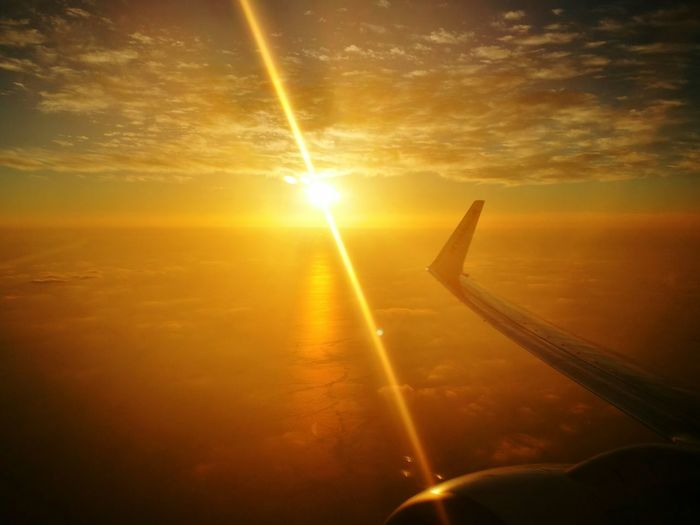 Sun Sunset Flightview Flight Sunlight Sunbeam Transportation Tranquil Scene Cloud Sky Orange Color Journey Airplane Wing Air Vehicle Beauty In Nature Cloudscape Nature Scenics Idyllic Tranquility Lens Flare Outdoors Holiday Perspectives On Nature