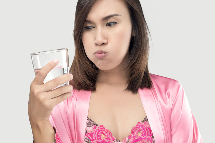 Beautiful Woman Casual Clothing Close-up Drink Drinking Drinking Glass Front View Gargle Glass Hairstyle Headshot Holding Indoors  Lifestyles Mouth Rinse Mouthwash One Person Pink Color Portrait Refreshment Studio Shot White Background Young Adult Young Women