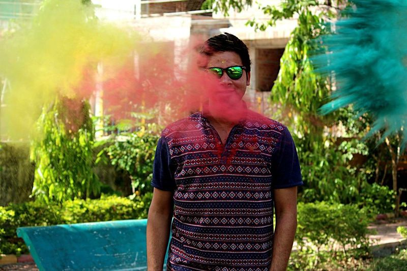 Close-up Holi Outdoors Day Sunglasses Waist Up Lifestyles Young Adult Standing Looking At Camera Festival India Colorsplash