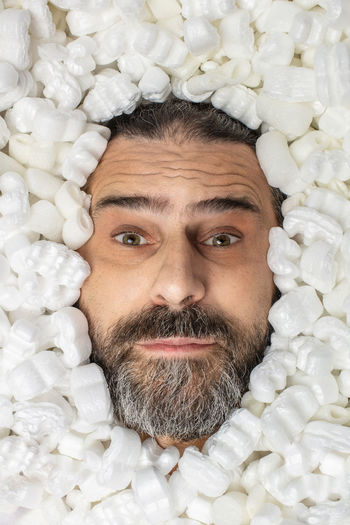 Close-up portrait of man covered with polystyrene