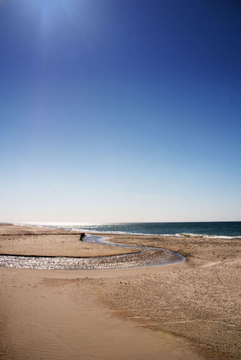 Coast in Vorupoer Denmark Arid Climate Beach Coastline Desert Exploring FootPrint Horizon Over Water Outdoors Remote Sand Sand Dune Sea Seascape Shore Tranquil Scene Tranquility Vacations Wave
