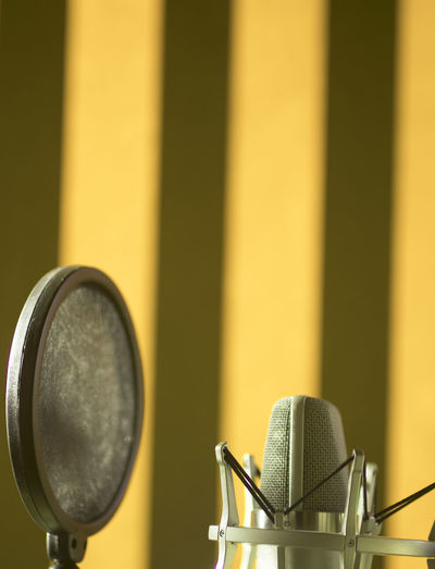 Close-up of microphone against wall