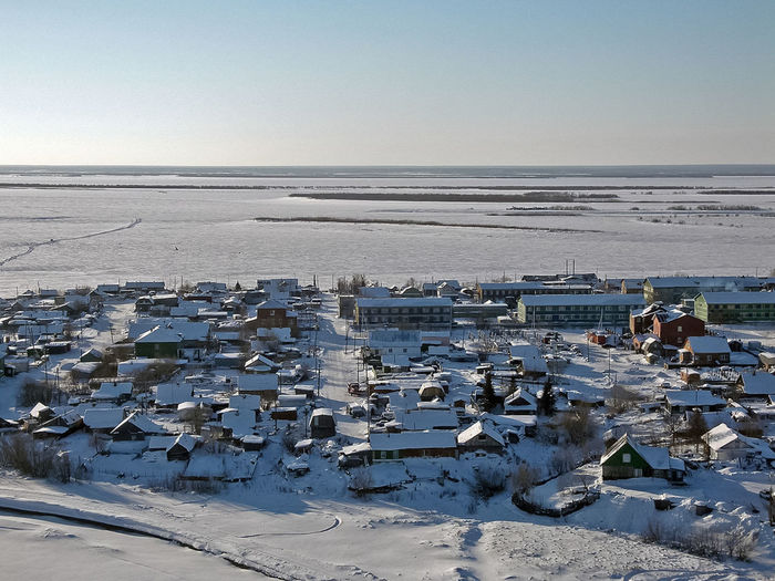 Aerial view of frozen sea against clear sky