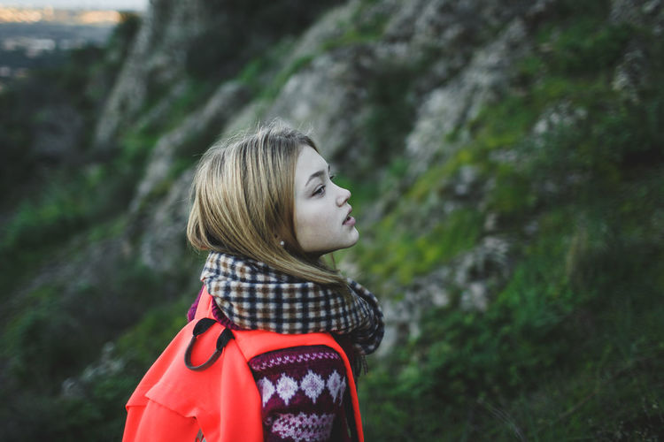Teenage Backpack Girl Hiking On Mountain
