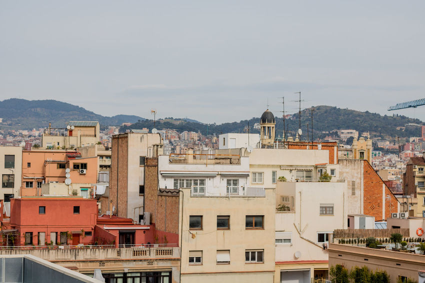 Building Exterior City Roof Business Finance And Industry Built Structure Architecture Cityscape No People Apartment Residential Building Outdoors Travel Destinations Urban Skyline Sky Building Terrace Day Mountain Crossing Architecture Portrait Of A City Skyline SPAIN Barcelona City Street Cityscape
