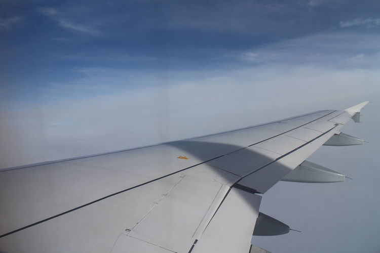 Air Vehicle Aircraft Wing Airplane Airplane Wing Close-up Cloud - Sky Day Flying Nature No People Outdoors Sky Transportation