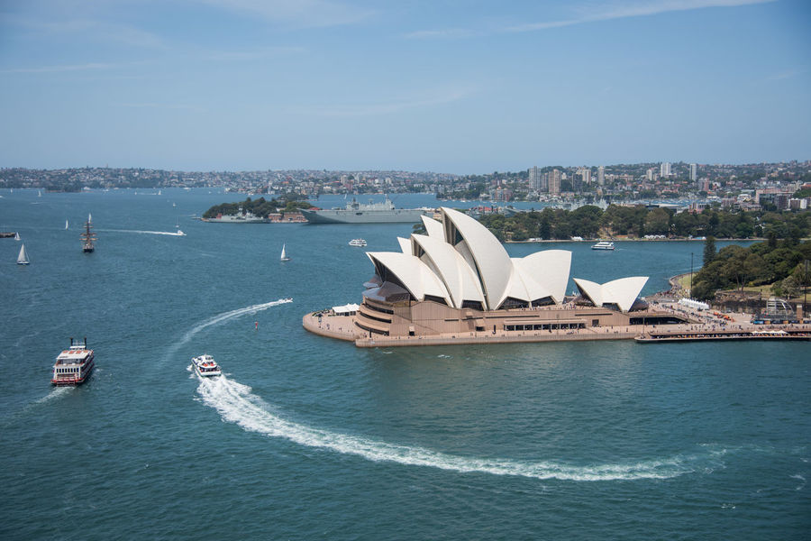 Sydney,NSW,Australia-November 20,2016: Elevated view over the Sydney Opera House at Bennelong Point with nautical vessels in Sydney, Australia. 20th Century Architecture Australia Cityscape Harbour Harbour View Roof Sydney Opera House Sydney Harbour  Tourists Transportation Traveling Bennelong Point Boat Cruisin Elevated View Famous Place Journey Landmark Motion Nautical Vessel Sydney Tourism Wake Water
