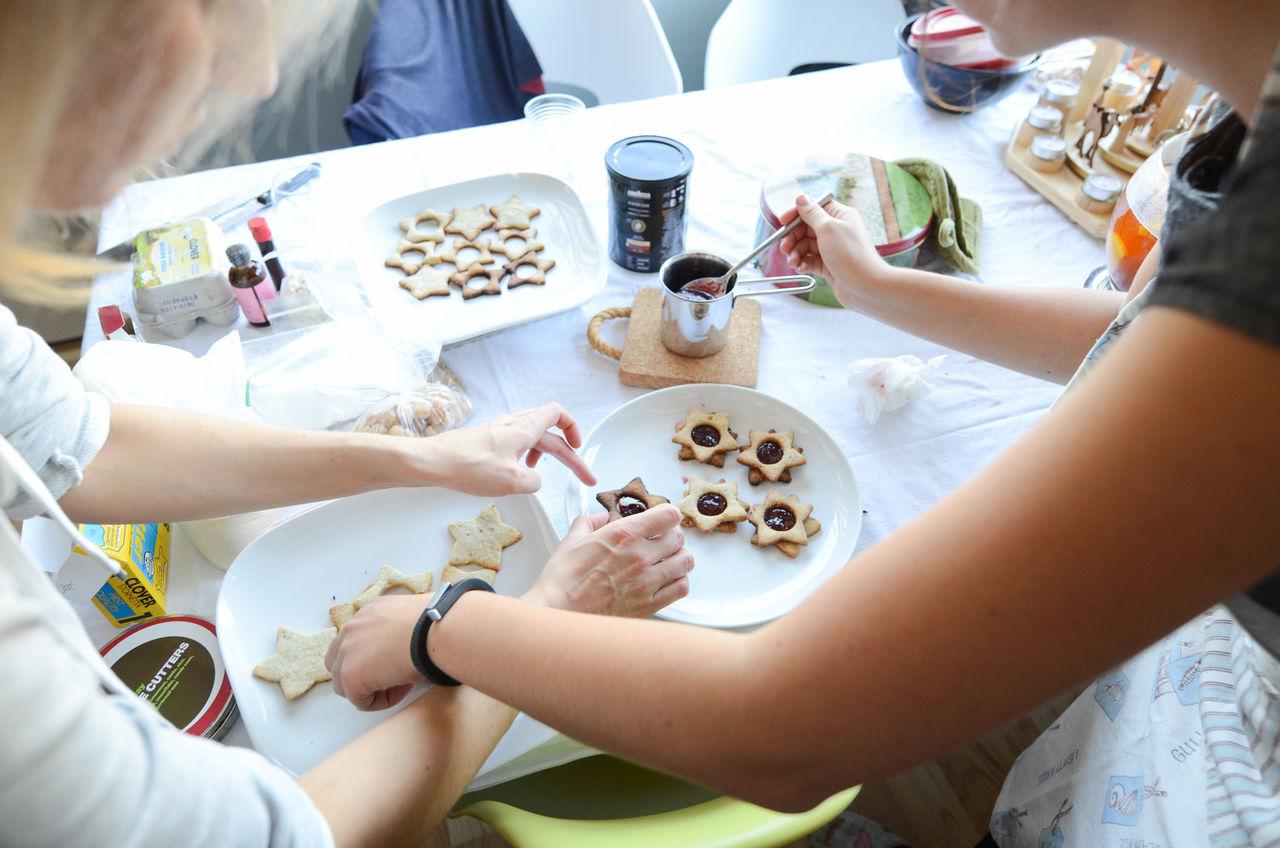 Two girlfriends preparing cookies