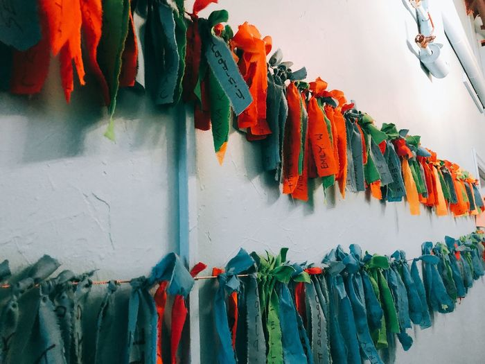 Ribbons hanging on string against wall