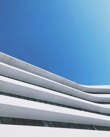 Waves in the sky Blue Architecture Sky Day No People Pattern The Architect - 2018 EyeEm Awards Built Structure Clear Sky Low Angle View Building Exterior Sunlight Outdoors Connection