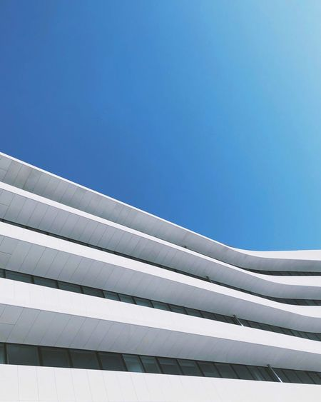 Waves in the sky Blue Architecture Sky Day No People Pattern The Architect - 2018 EyeEm Awards Built Structure Clear Sky Low Angle View Building Exterior Sunlight Outdoors Connection The Architect - 2018 EyeEm Awards
