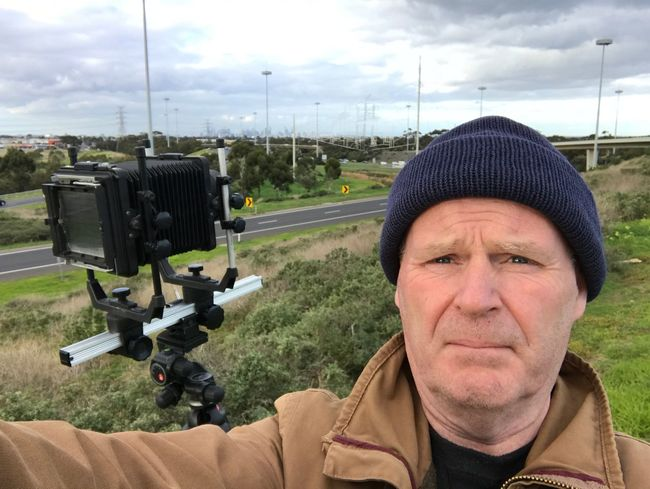 One Person Portrait Real People Headshot Sky One Man Only Looking At Camera Photographer Cloud - Sky Outdoors Adult Camera Camera - Photographic Equipment Landscape Urban Skyline Urban Landscape