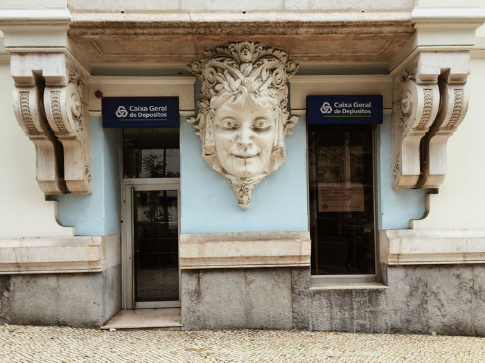 Statue in front of door