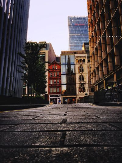 Architectural contrasts of London Architecture Building Exterior City Built Structure City Street Street Travel Destinations Skyscraper City Life Outdoors No People Modern Day Cityscape Sky Diversity Travel Brick Road Streetphotography Old Buildings Architecture Low Angle View Row Of Things City Street London EyeEm LOST IN London Postcode Postcards