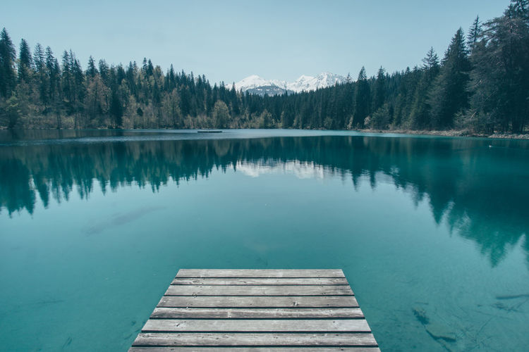Jetty view at lake Crestasee in Flims, Switzerland Beauty In Nature Blue Calm Crestasee Idyllic Jetty Jetty View Lake Landscape Mountain Lake Mountain View Nature Non Urban Scene Outdoors Pier Reflection Remote Schweiz Standing Water Suisse  Switzerland Tranquil Scene Tranquility Tranquility Water