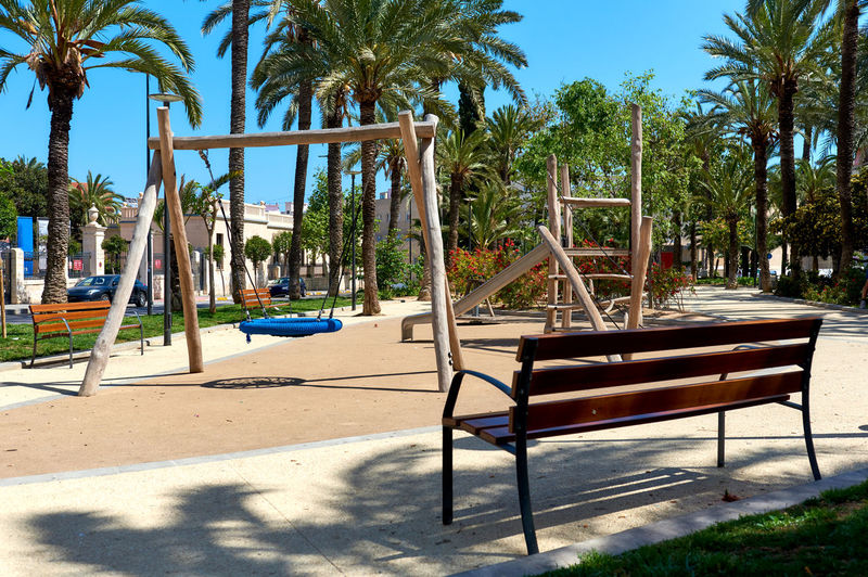 Wooden playground. Alicante city, Costa Blanca. Spain Alicante Alicante, Spain Costa Blanca Playground Structure Playground Equipment SPAIN Wood Amusement Park Beauty In Nature Childhood Day Entertainment Park Landscape No People Nobody Outdoors Palm Tree Park - Man Made Space Playground Sand Scenery Springtime Summer Sunlight Wooden