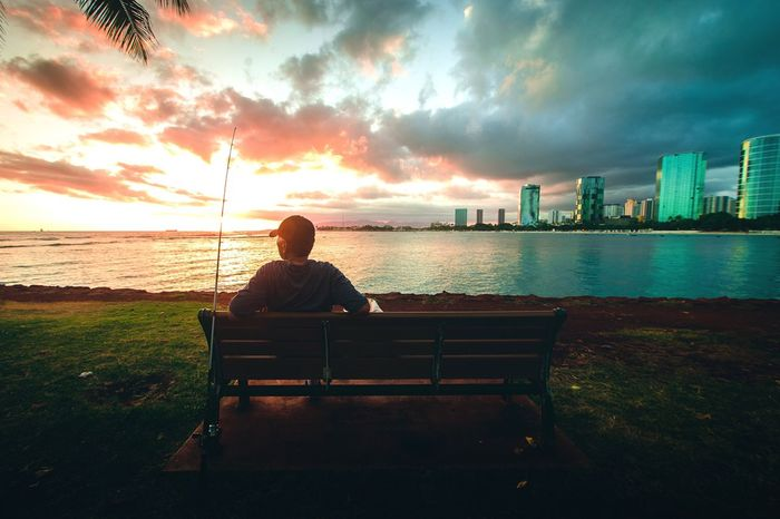 Had to take this shot quick Sitting Sunset Rear View Sky Cloud - Sky Bench Leisure Activity Real People Men One Person Water Sea Nature Outdoors Full Length Beauty In Nature Young Adult Horizon Over Water One Man Only Day Sunset The Secret Spaces TCPM