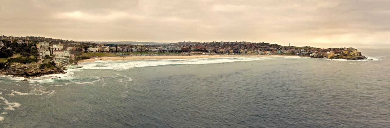 Aerial Panoramic shot of Bondi Beach, Australia. Bondi Beach Drone  Sydney Beach Sydney, Australia Architecture Beach Beauty In Nature Cloud - Sky Coastline Dronephotography Land Motion Nature No People Outdoors Power In Nature Rock Rock - Object Scenics - Nature Sea Sky Sydney Water Wave