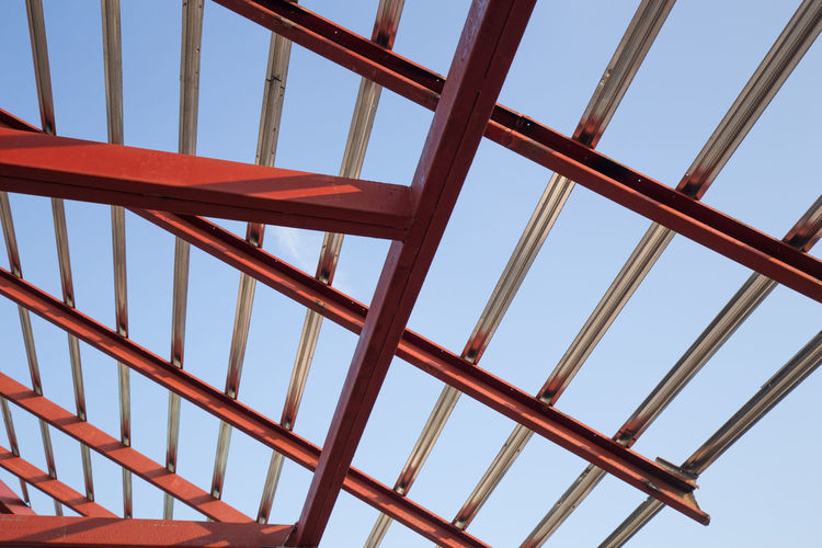 Steel Construction Roof New Structure Metal Home Worker Sky Frame Blue Site Background Factory Structural House Building Under Industrial Material Industry Truss Iron Development Build Framework Design Residential  Roofing Architecture Work Beam Exterior Workplace Project Residence Housing Ceiling Unfinished Pillar Pole