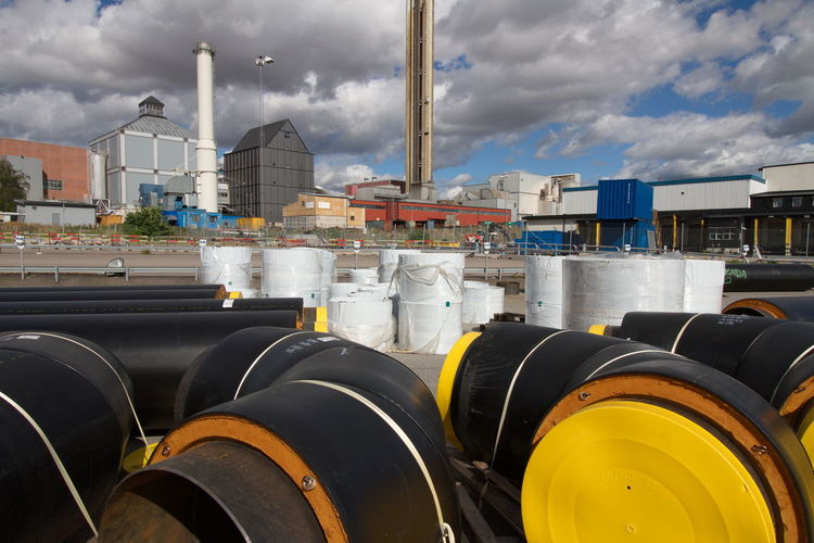 complex composition showing Uppsala Vatten in background with pipeline construction in foreground Chimneys Cityscape Complex Construction Work Mode Of Transport Pipe Pipeline White Yellow Working No Pepole