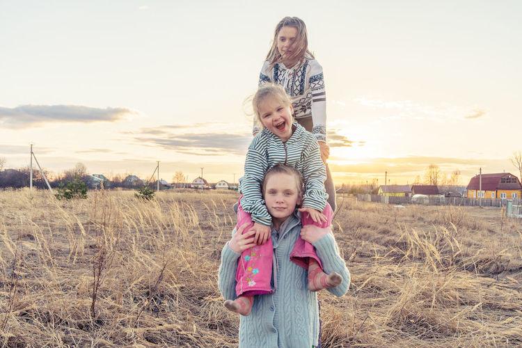 Sisters International Women's Day 2019 Child Females Togetherness Childhood Beach Sunset Bonding Sea Girls Summer