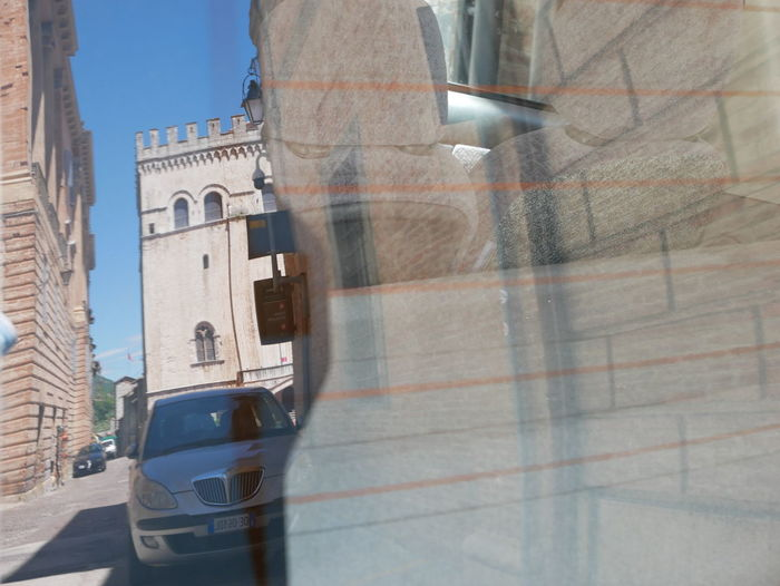Reflection of buildings on road in city
