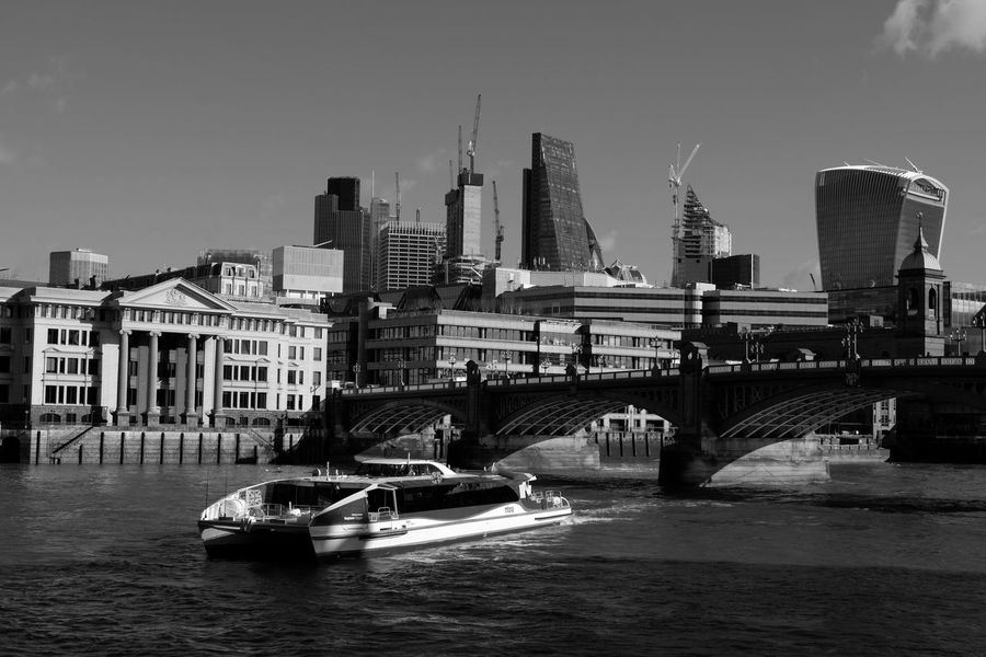 A Thames Clipper boat taking commuters and tourists up and down the Thames river in London. Commuting Ferry Ferryboat London Bridge Mobility In Mega Cities Thames Thames River Side Thames Clipper Tourists Architecture Bridge - Man Made Structure City Cityscape Clear Sky Modern Nautical Vessel Outdoors River Sky Skyscraper Tourism Transportation Urban Skyline Water Waterfront