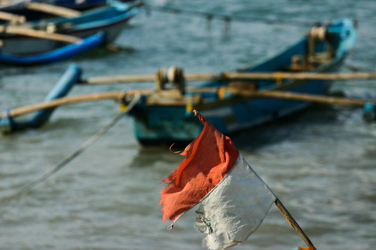 Indonesian flag flying at the boat