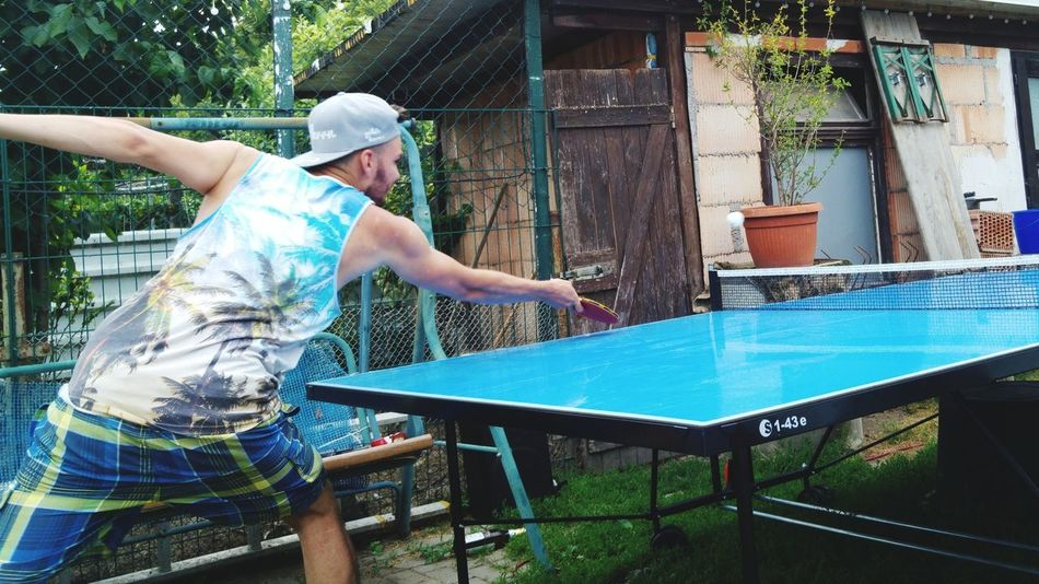 Casual Clothing Outdoors Two People Day Real People Lifestyles Playing Spraying Togetherness Working Tree People Building Exterior Adult Adults Only Young Women Young Adult Tabletennis