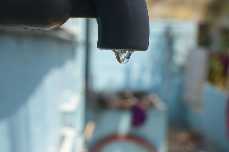 Close-Up Of Water Drop On Faucet