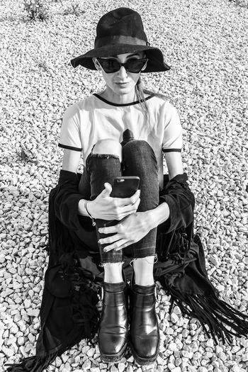 Full length of woman sitting at beach