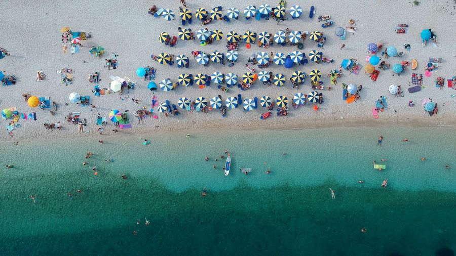 Drone View Of People At Beach