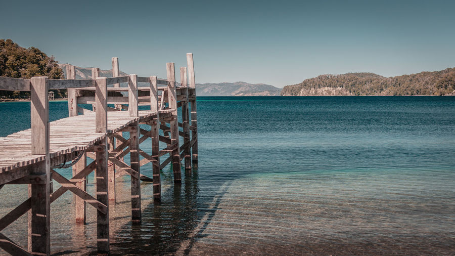 Water Sea Sky Mountain Beauty In Nature Tranquil Scene Scenics - Nature Tranquility No People Nature Wood - Material Day Clear Sky Beach Land Pier Built Structure Architecture Railing Outdoors