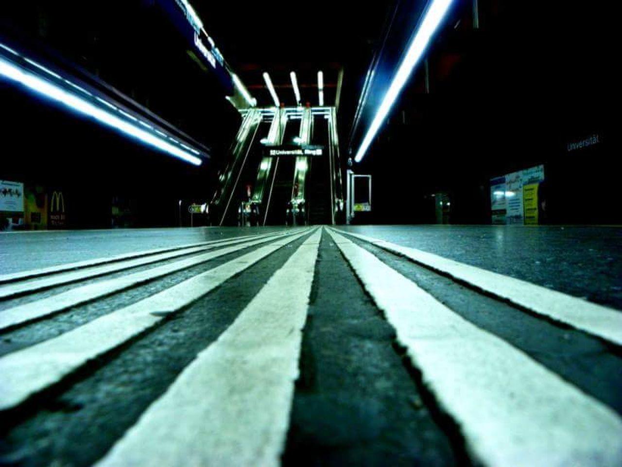 transportation, surface level, empty, illuminated, no people, railroad track, night, indoors, the way forward