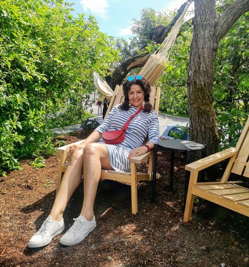Me Norway Tree Portrait Full Length Sitting Smiling Looking At Camera Chair Relaxation Women Beautiful Woman Outdoor Chair Deck Chair